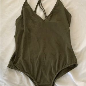 Army green form fitting body suit.